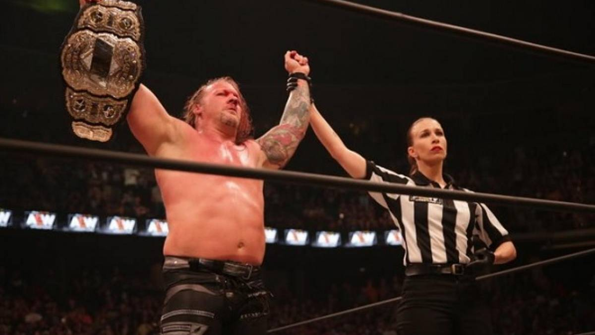 Chris Jericho holding the AEW Championship after being crowned their first champion
