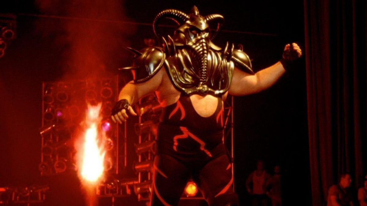 Big Van Vader walks to the ring in his ceremonial mask, as pyro pops behind him