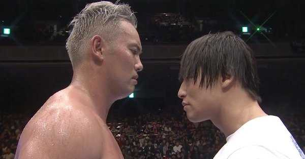Okada and Ibushi stare each other down in the ring