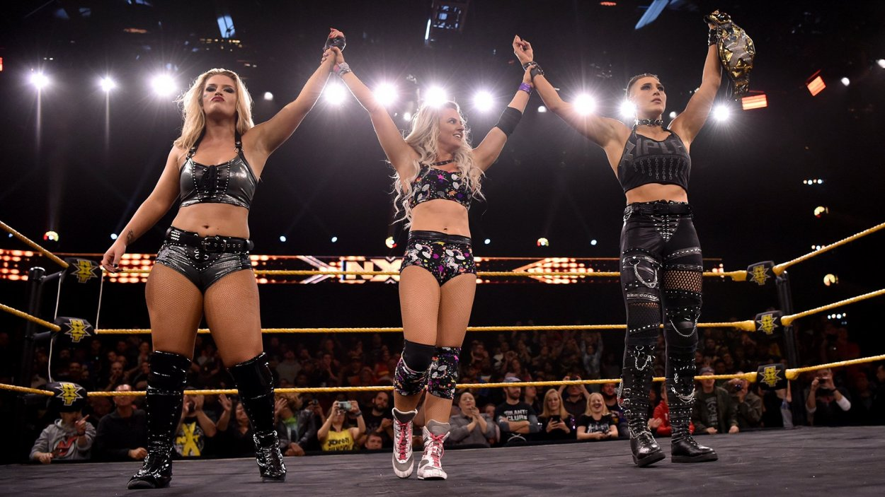Candice LeRae, Rhea Ripley and Toni Storm in the ring