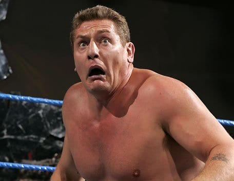 William Regal pulls a panicked face