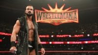 Drew McIntyre in the ring with the WrestleMania sign behind him
