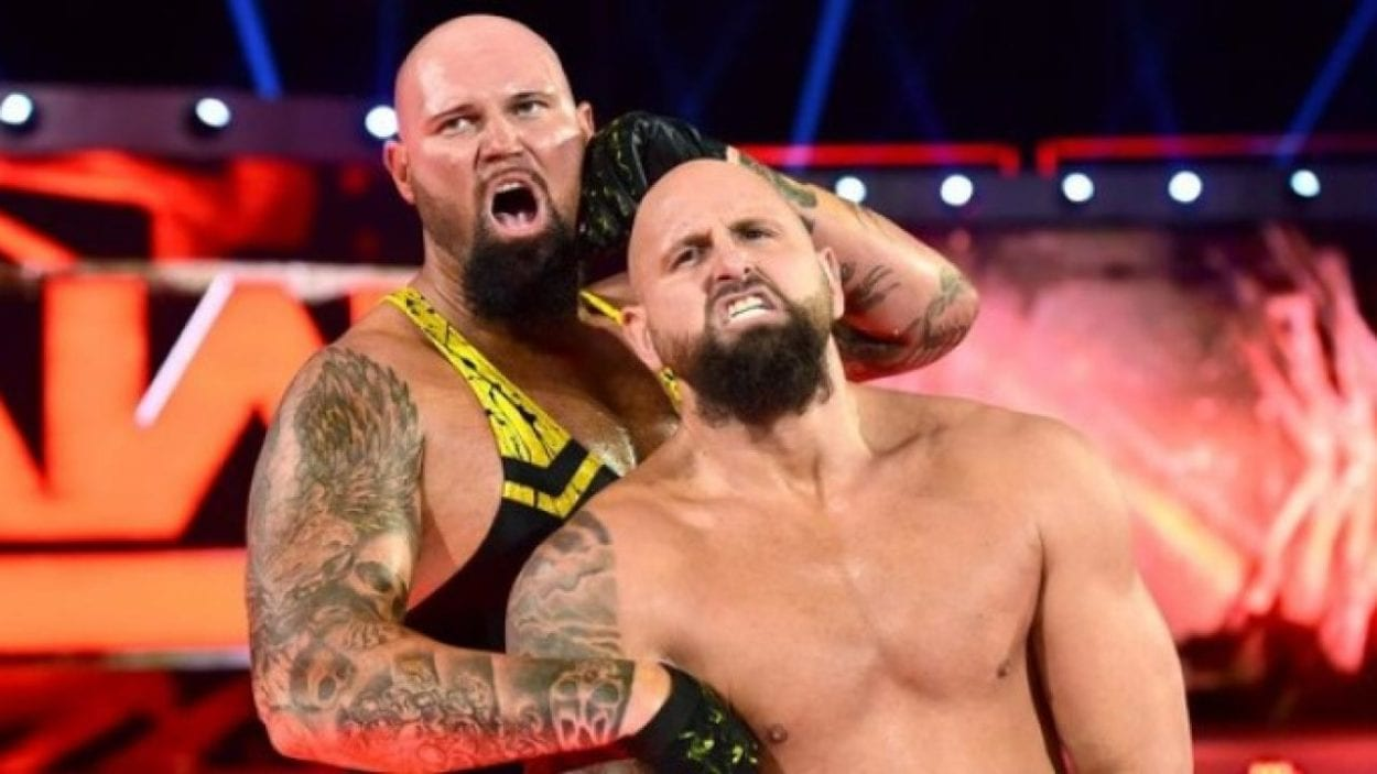 Luke Gallows and Karl Anderson grimacing on the Raw set