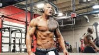 The Rock with headphones on at the gym