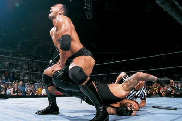 The Rock performs the Shap Shooter to The Undertaker