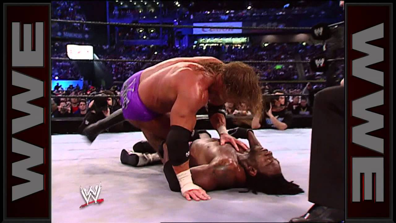 Triple H Buries Booker T