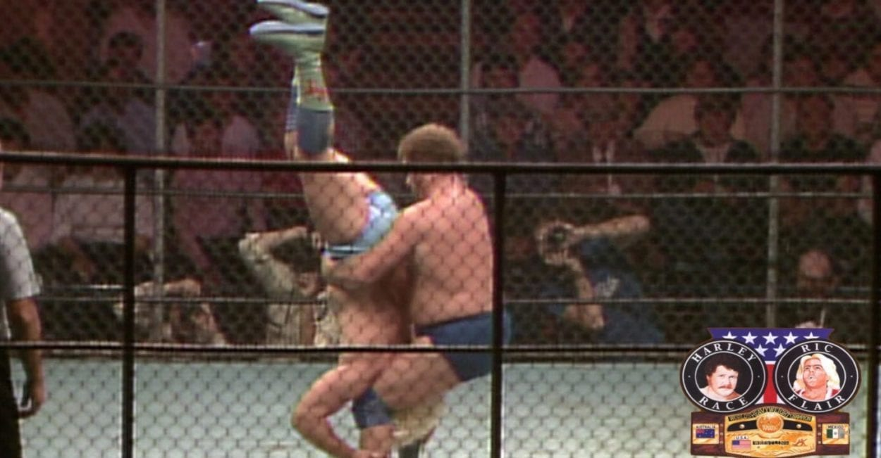 Harley Race prepares to piledrive Ric Flair inside a steel cage