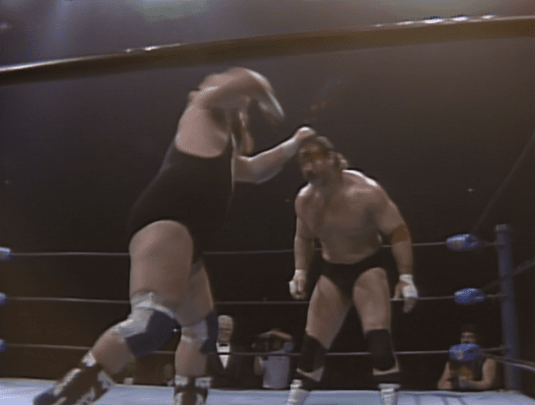 Black Bart takes a swing at a bloody Manny Fernandez