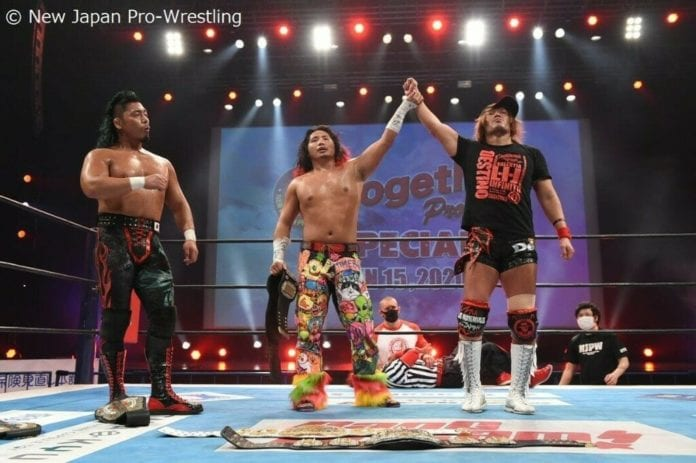 Takahashi and Naito raise each other's hands as Shingo looks on