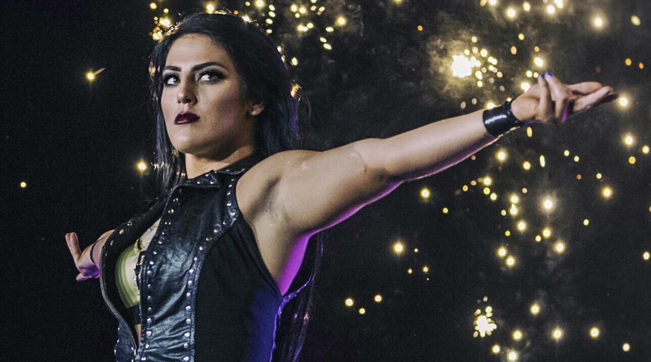 Tessa Blanchard raises her arms against the hit of pyro