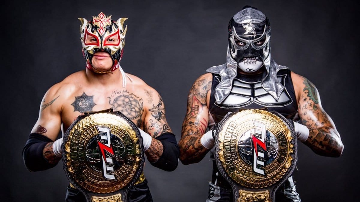 Pentagon Jr and Rey Fenix pose with their MLW tag title belt