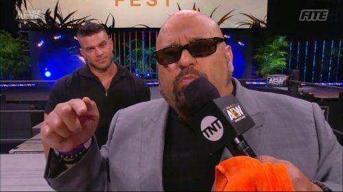 Taz addresses the camera as Brian Cage smirks behind him at AEW Fyter Fest