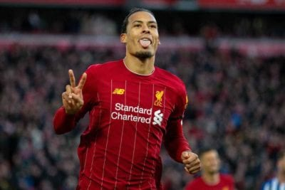 Virgil Van Dijk sprint away in celebration with his tongue sticking out and with two fingers raised in the air