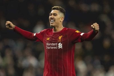 Roberto Firmino stands with his arms outstretched in celebration
