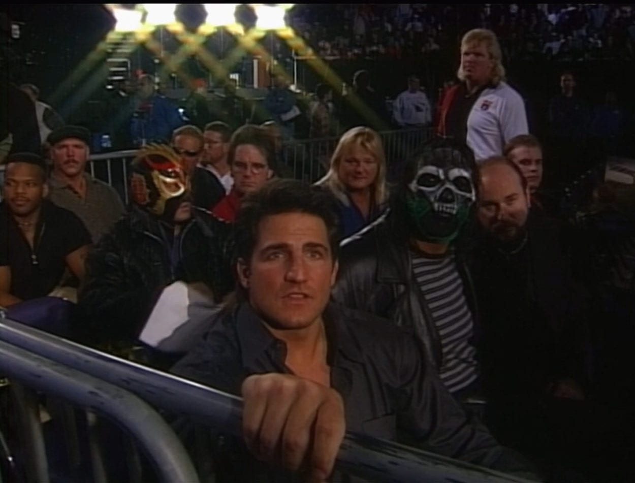 WCW wrestlers in the stands at Starrcade 1997