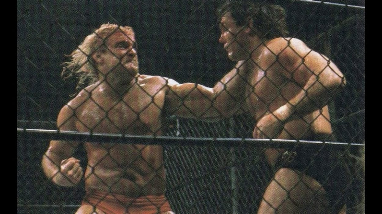 Magnum T.A. takes a swing in the cage at Tully Blanchard