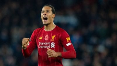Virgil Van Dijk celebrates with two clinched fist and his mouth agape