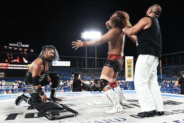 Dick Togo throttles Naito as EVIL grabs a chair