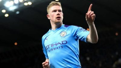 Kevin De Bruyne wheels away in celebration with a finger poiting to the crowd