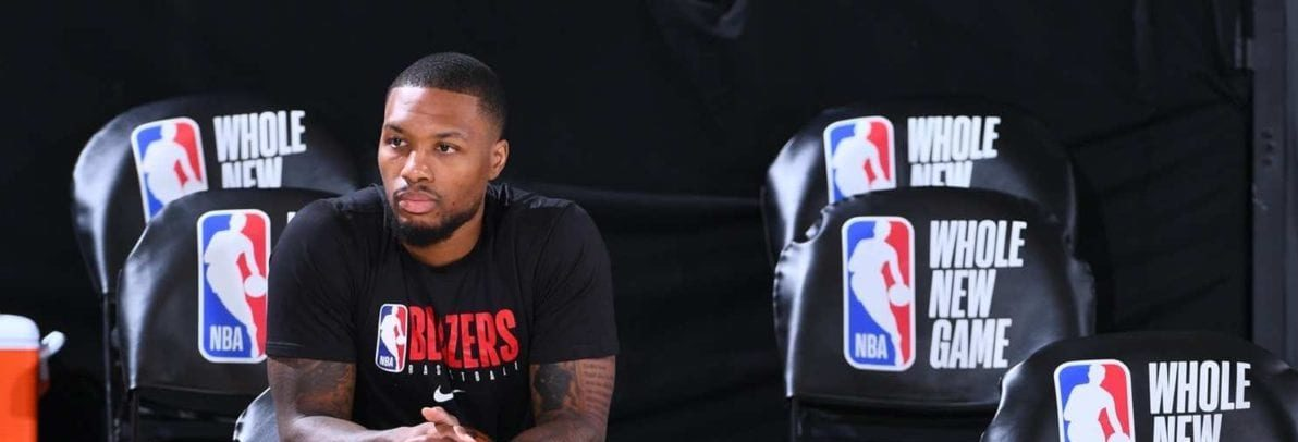 Damian Lillard sits alone, during his teams pre-game shoot around.