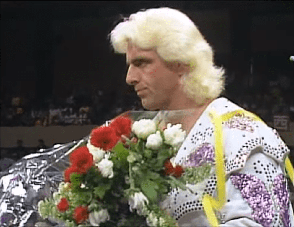 Ric Flair hold flowers given to him by Japanese ring girls