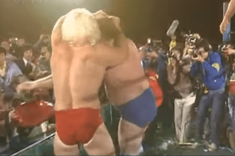 Ric Flair grabs Harley Race to send him into the guard rail
