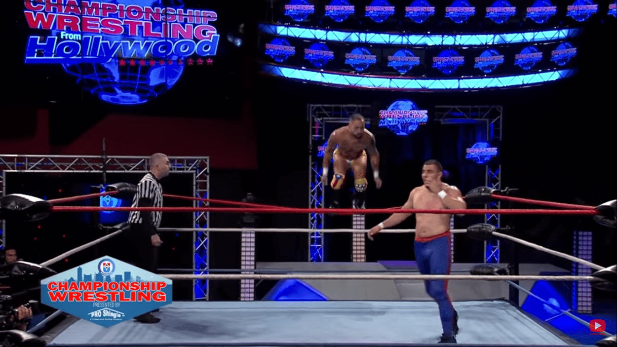 Danny Rivera prepares to leap off the top rope onto Slim Boogie