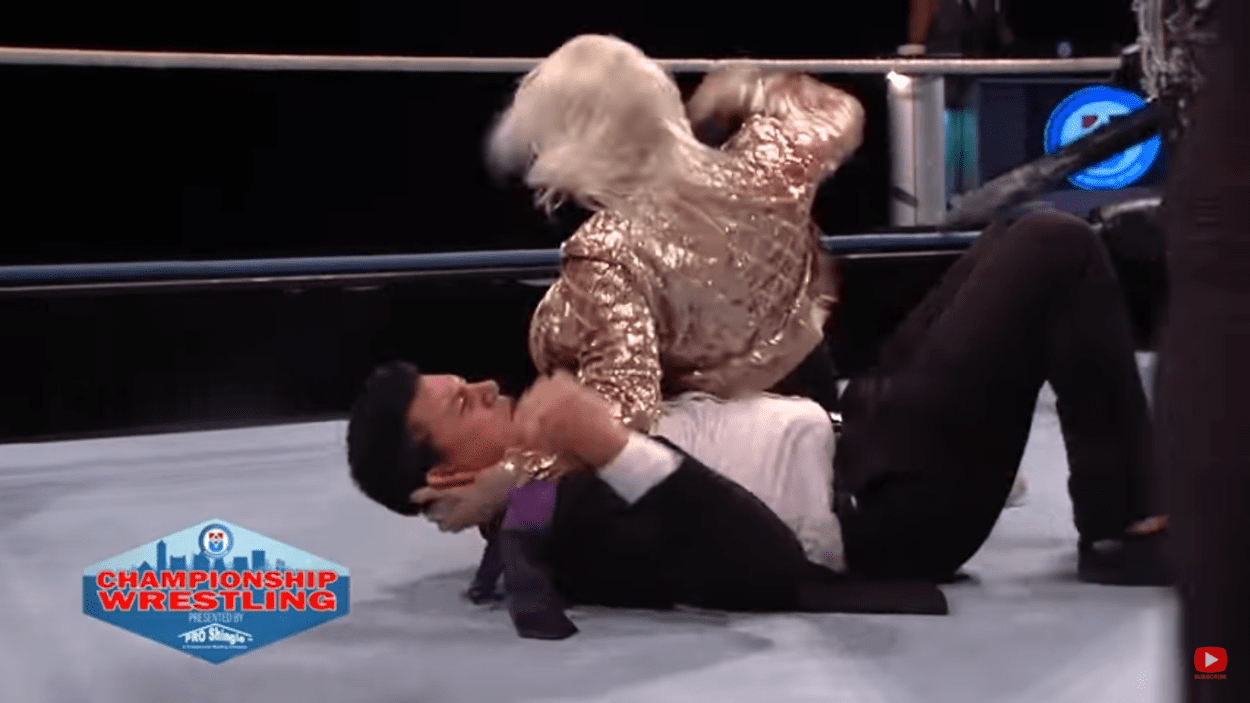 Heather Monroe lays the fists into Nikko Marquez on Championship Wrestling