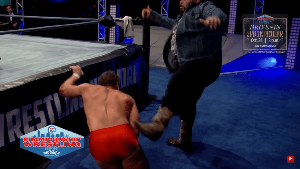 Howdy Price gives Dan Joseph a kicking at ringside