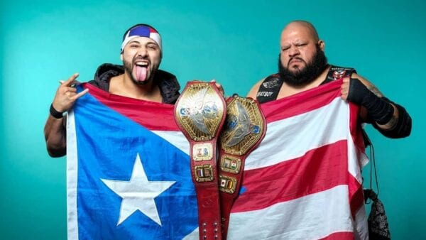 The Bodega (Danny Limelight and Papo Esco) pose with their newly-won UWN Tag Team Title belts
