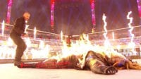 Randy Orton looks on as The Fiend lies covered in flames at WWE TLC 2020