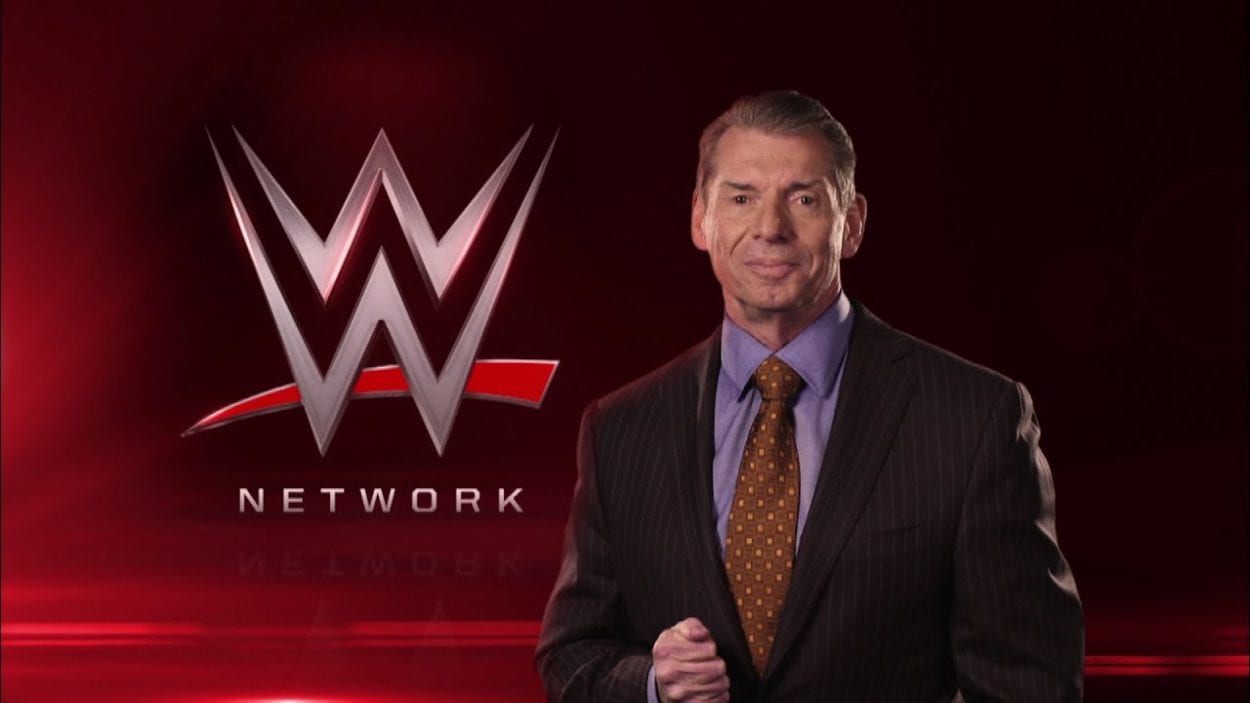 Vince McMahon in front of WWE Network logo