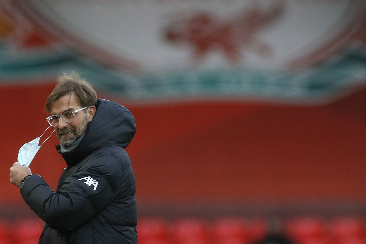 Jurgen Klopp walks off after the Man Utd match, looking dejected and removing his facemask.