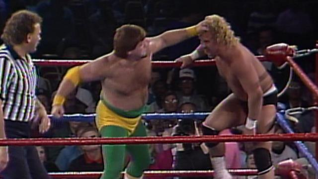 Jerry Lawler takes a swing at Curt Henning