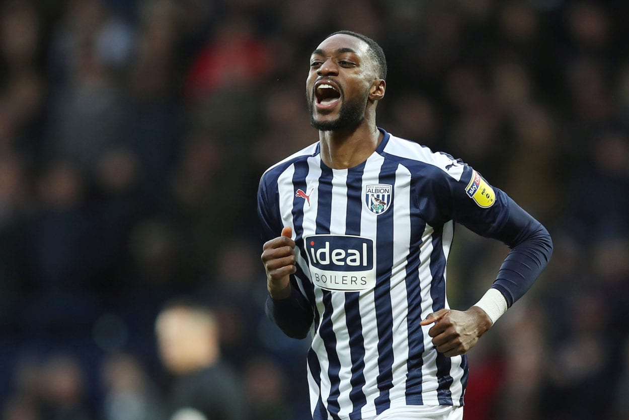 West Brom Defender celebrates his team scoring a rare goal.