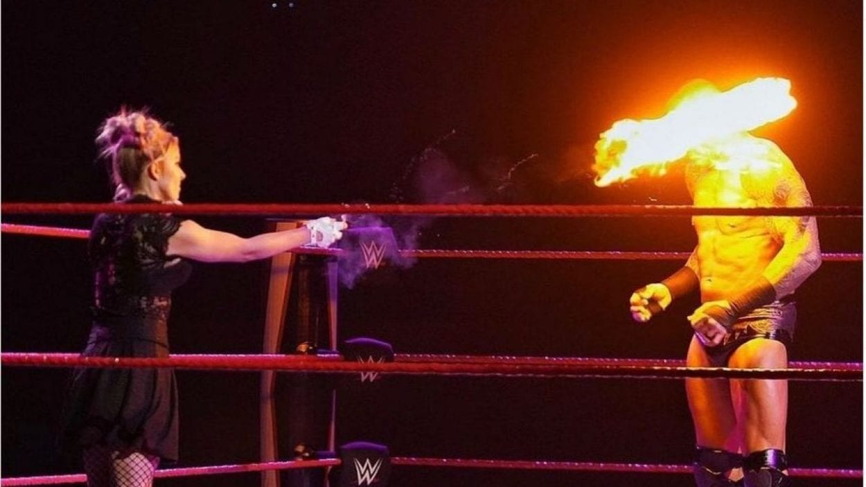 Alexa Bliss throws a fireball in Randy Orton's face