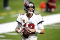 Tom Brady clutches the ball in the Buccaneers uniform