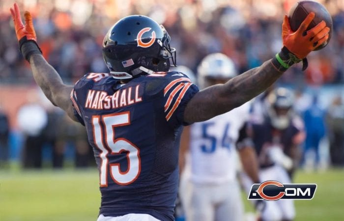 Receiver Brandon Marshall stands with arms outstretched after catching a pass. He is facing away from the camera. His first season with the Bears was one of the greatest receiver debuts of all time.