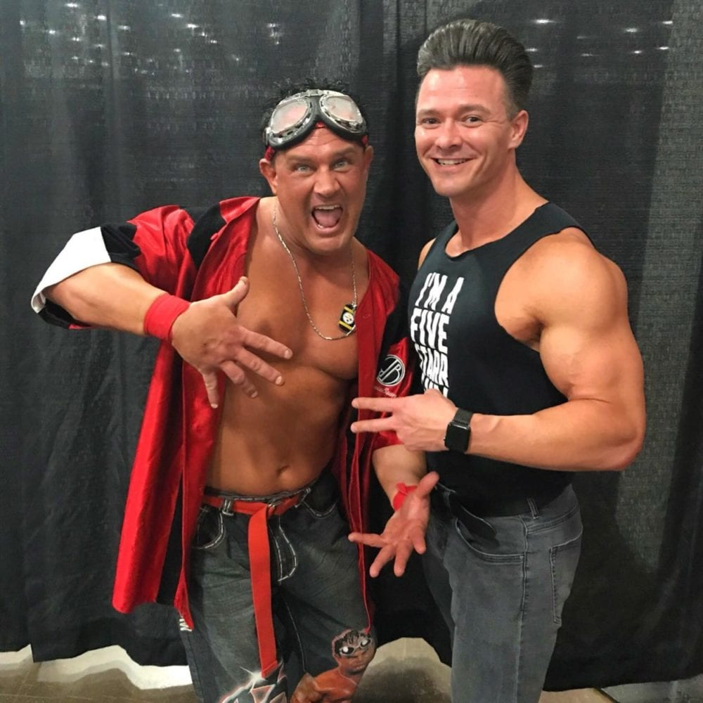 Brian Christopher and Dustin Starr pose together backstage