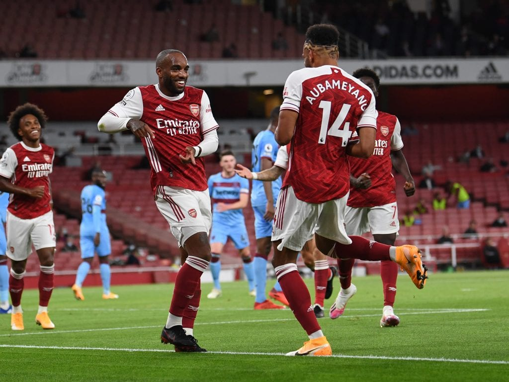 Arsenal players celebrate scoring a rare goal