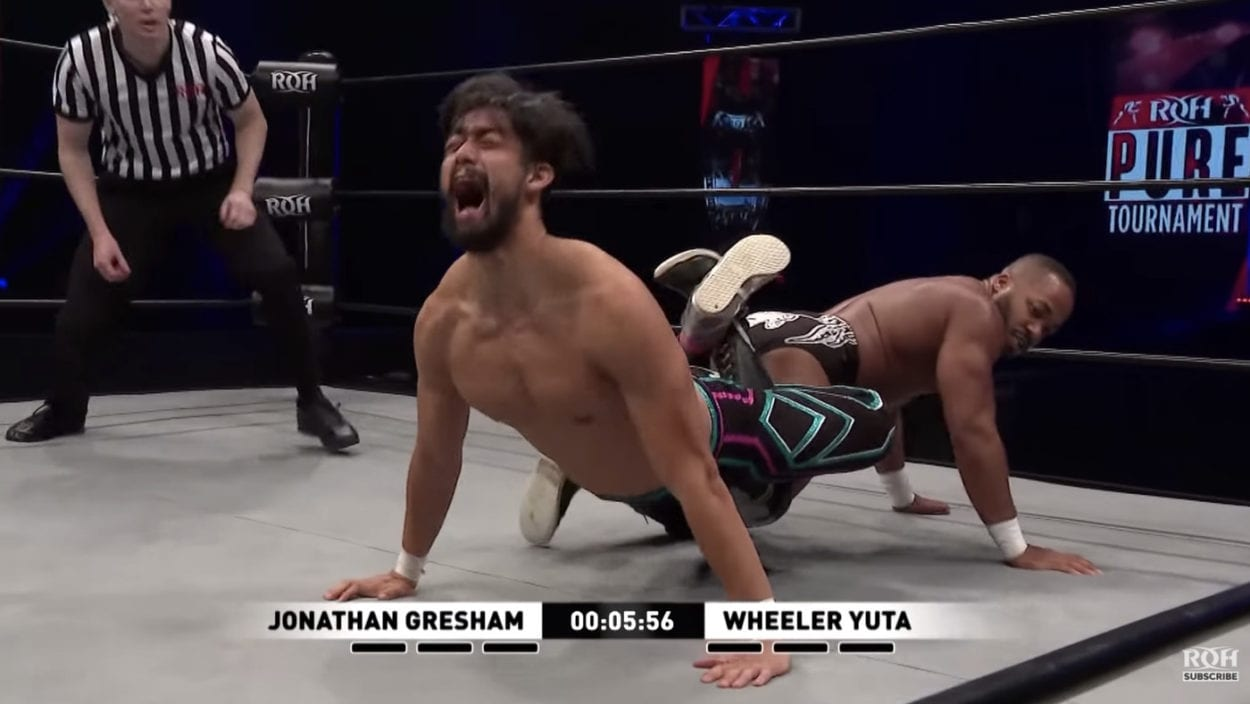 Jonathan Gresham has Wheeler Yuta locked up in a nasty-looking leglock