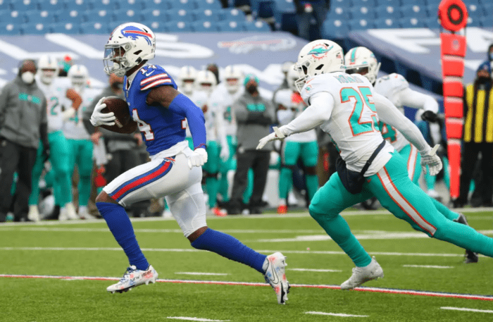 Stefon Diggs runs away from a Dolphins defender as he sprints down the field. Diggs' first season with the Bills was one of the best receiver debuts of all time.
