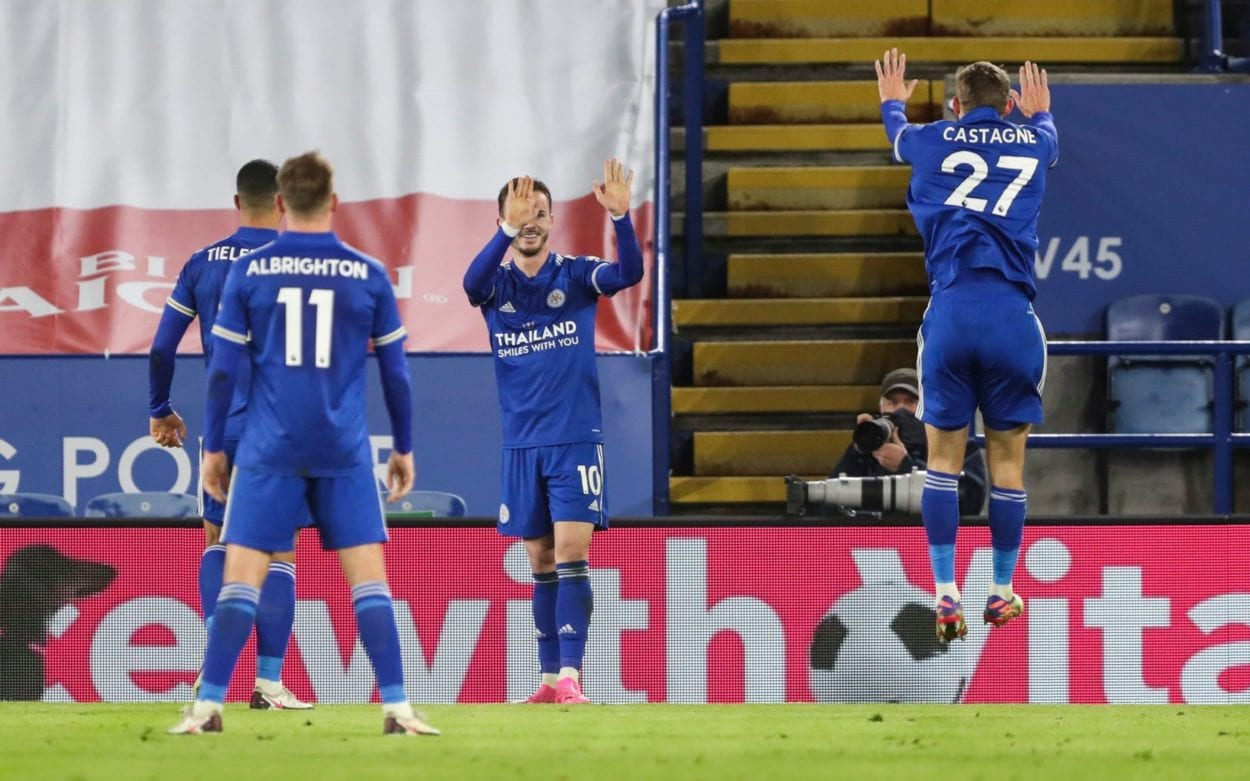 James Maddison and team mates celebrate his goal, social distance style.