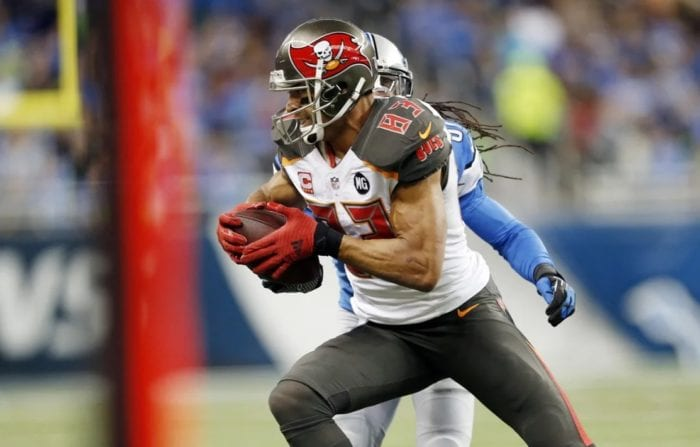 Vincent Jackson makes a catch in front of a Detroit Lions defender. Jackson's first season with the Bucs was one of the best receiver debuts of all time.