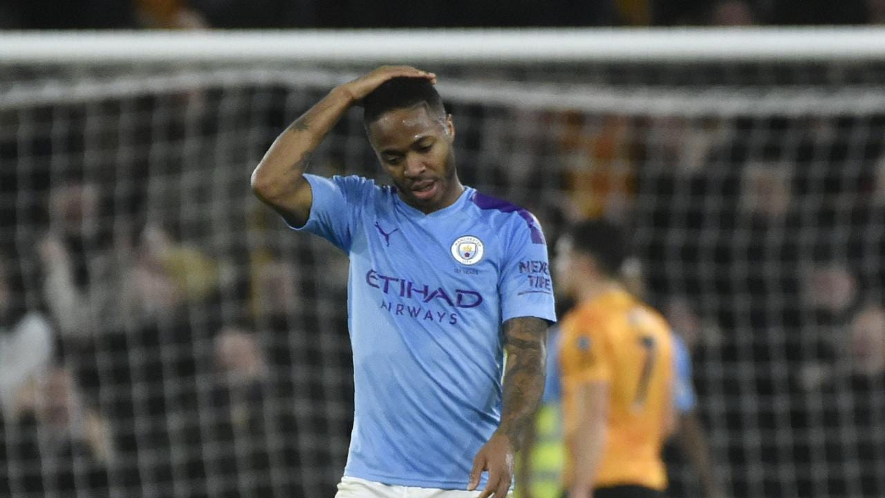 raheem Sterl;ing stands with a hand on his head after missing an absolute sitter