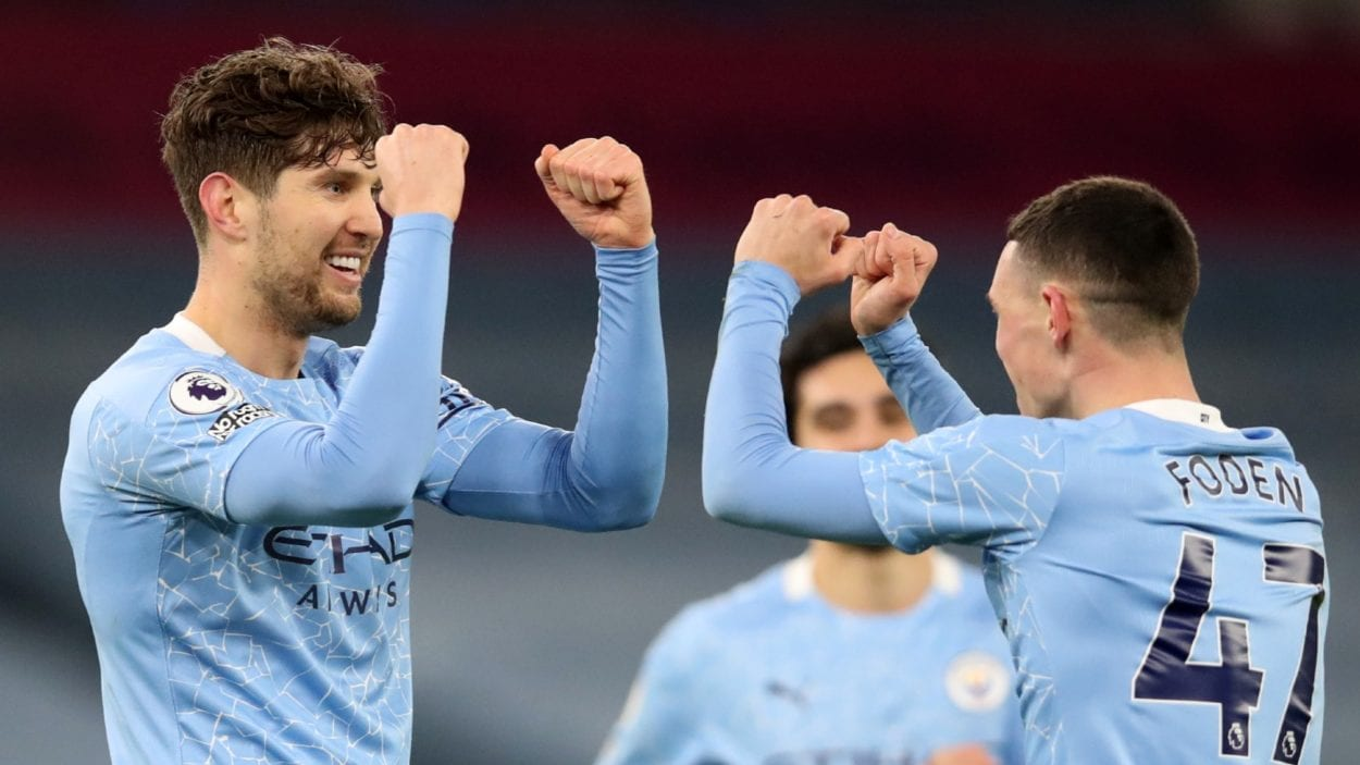 John Stones and Phil Fodden celebrate a goal against Crystal palace