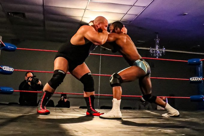 Norman Meklakov and Ryan Rembrandt tie up on Championship Wrestling from Memphis