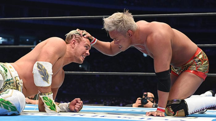 Okada has some angry words for Ospreay on the mat at Wrestle Kingdom 15