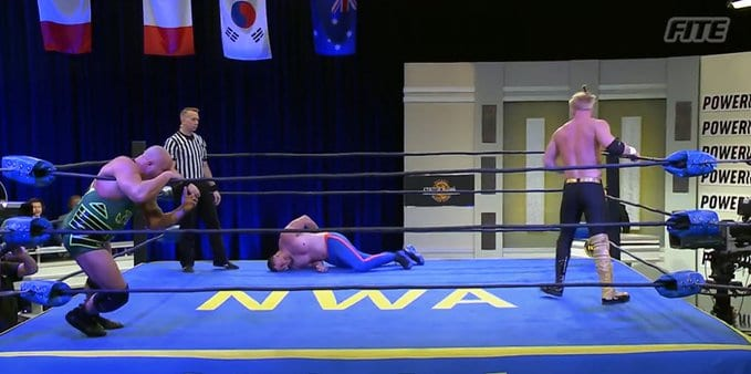 Jordan Clearwater stares down a downed Slice Boogie as Jax Dane looks on at NWA Back For The Attack