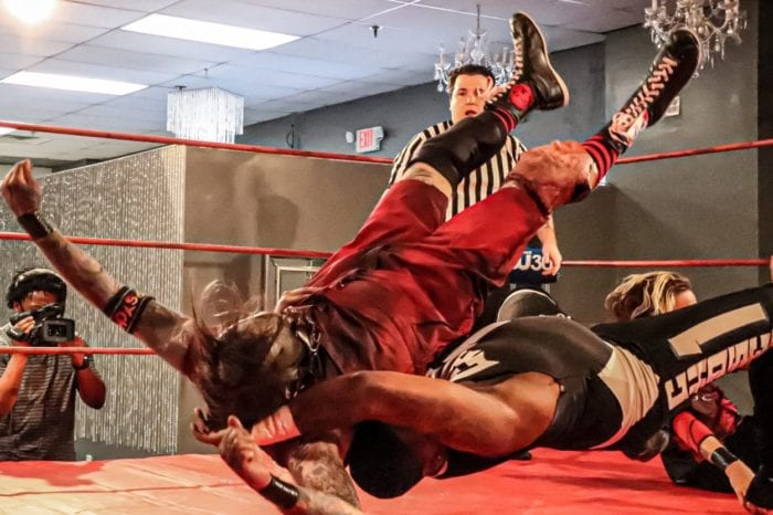 Otis Crowley is belly-to-back suplexed by Zay Washington